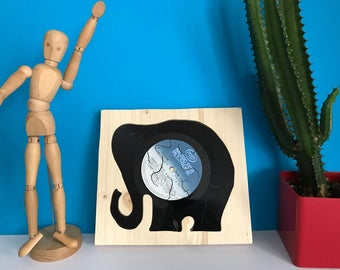 8 puzzle pieces of wood and vinyl record