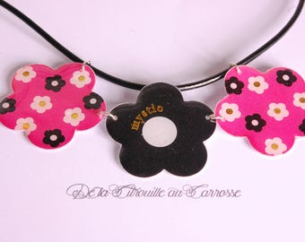 Floral design on a pink background and black flowers bib necklace