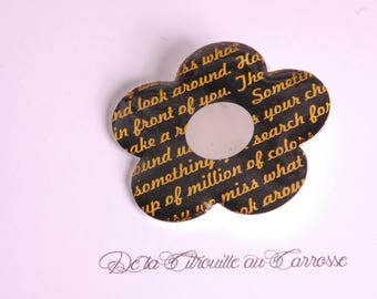 Flower brooch, black and gold