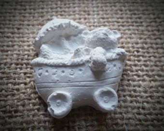 Decorative bear in his cradle raw plaster