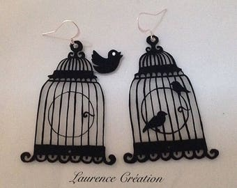 Earrings made of plastic crazy black and white bird cage.
