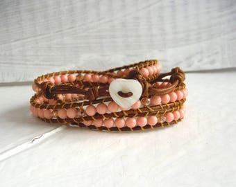 Bracelet type chan luu in coral pink/wrap bracelet