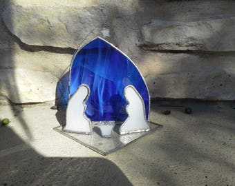 Modern Nativity scene in blue glass