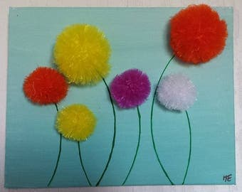 Stylized and colorful tassels with organza flowers