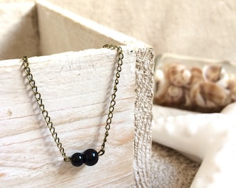 Bracelet chain and small black beads
