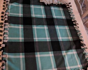 Adorable plaid tied fleece blanket