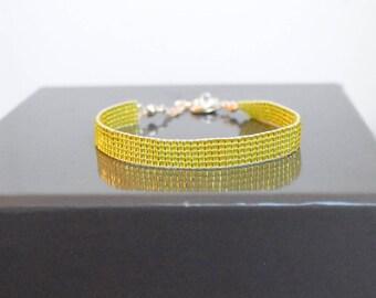 Light green woven bracelet shiny glass beads