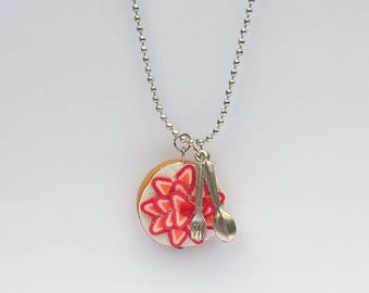 Necklace with polymer clay strawberry pie