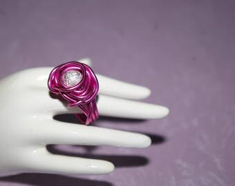 Stardust bead and pink aluminum wire ring