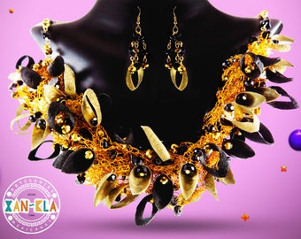 Handmade golden necklace made of cocoon