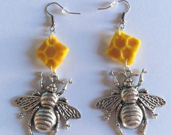 Bee earrings and a piece of honey
