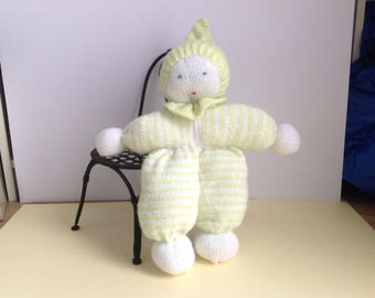 Green and white striped knit cuddly doll