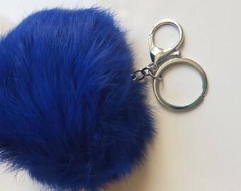 1x gros pompon en fausse fourrure couleur bleu nuit