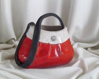 Red Raku firing hand bag