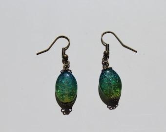 Green and blue dangling earrings