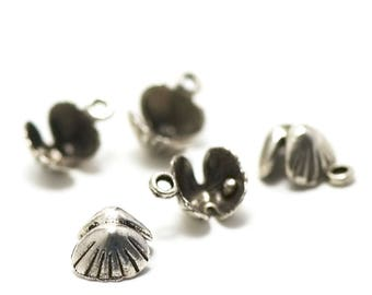 "Has 10 ""seashell 3 D"" charms, 14 x 10 x 6 mm, silver, 065"