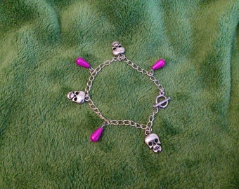 flashy pink skulls and drops charms bracelet