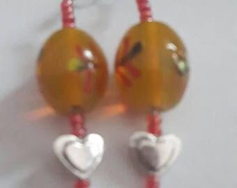 Pair of dangling earrings