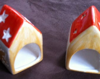 Candles in little houses with roofs star shaped porcelain
