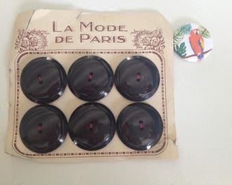 Old plate of 6 black buttons