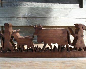 Poya natural wood dark cows and Shepherd fretwork