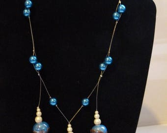 MID LONG BLUE BEADS AND CABOCHONS BRASS NECKLACE