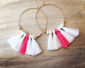 Earrings with large white and fuscia pink tassels with gold wire