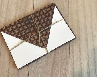 Four lined envelopes with notecards