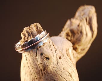 "Silver ring original and handcrafted earmuff ""pluma"""
