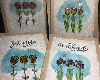 Handmade watercolor and tissue paper art cards with 4 different sentiments.
