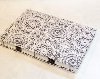 Crazy lace Coptic binding covered with fabric A5 size