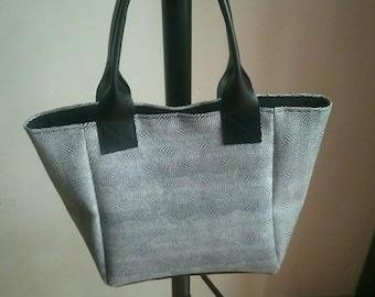 Black and white imitation leather handbag