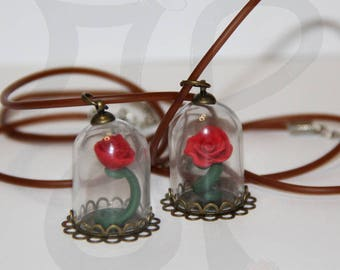 Rubber necklace with rose in the bell jar. The Beast and the Beauty