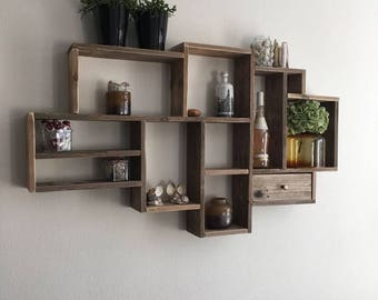 Wooden wall cupboard with pockets