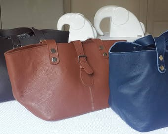 Crossbody bag in leather and wax