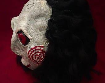 SAW shrunked head ornament