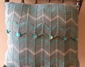 Hand knitted cheveron cushion