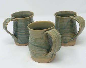 Set of three hand crafted mugs.