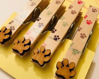 Magnetic pegs with animal paw embellishments