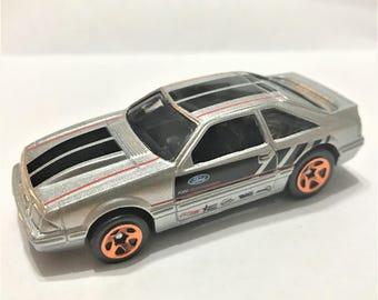 Fridge Magnet:Silver & Black '92 Ford Mustang Hot Wheels®