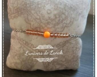 Orange bracelet chain and beads