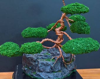 Twisted Copper wire sculpture clasped to rock