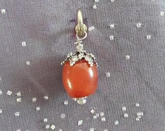 Pendant made with precious stone.