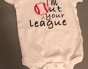 """Onesie with """"I'm out of your league"""" saying on it. Customizable."""