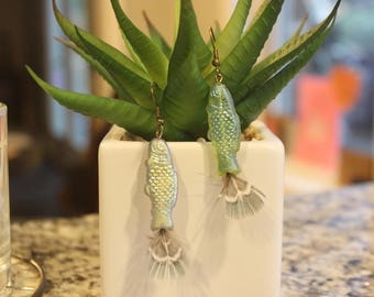 Fish and feather earrings on a nickel free hook, blue green, sparkly