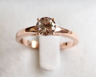 14 K rose gold solitaire woman's ring