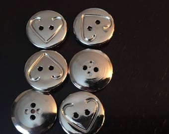 6 buttons with heart chrome finished plastic.