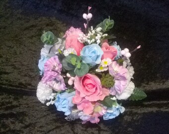 Straw basket filled with pretty pastel colours