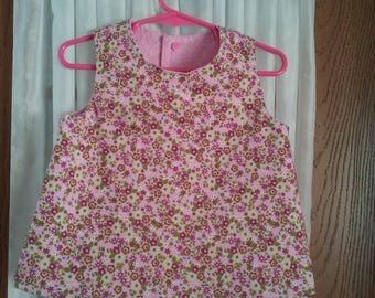 Girls 3T reversible sleeveless  pink calico, and pink eyelet top.  Snap back. Coordinating lined elastic waist shorts measuring 20.50
