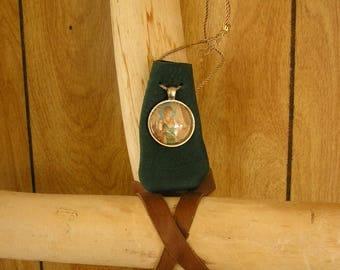 "Green leather drawstring pouch with Fairy charm, adjustable drawstring neckcord, 3"" x 1 1/2"", talisman bag"